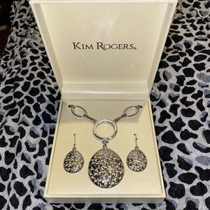 Silver necklace set with matching earrings.